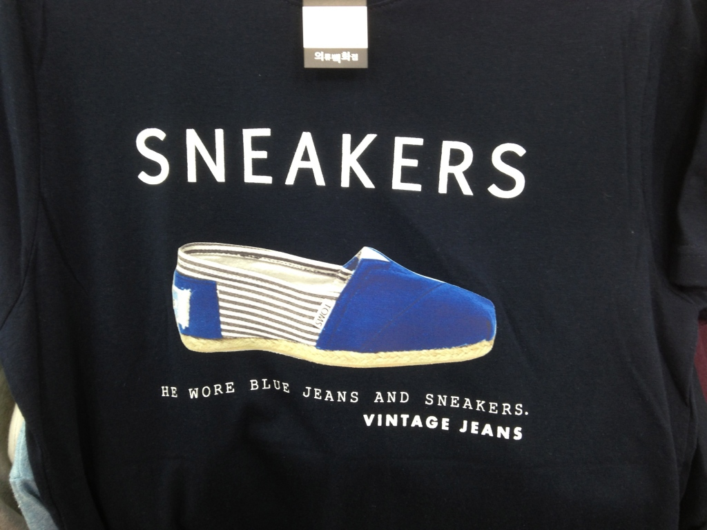 Korean T-Shirt: He wore blue jeans and sneakers